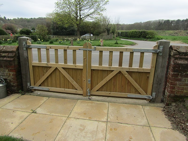 Wooden or metal electric gates – which is right for you - TPS Industrial